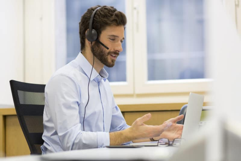 Businessman using a headset for speech recognition.